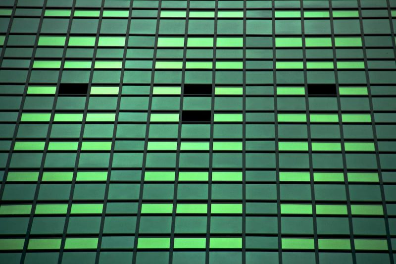 recurring payment plan metaphor with green tinted windows on large building