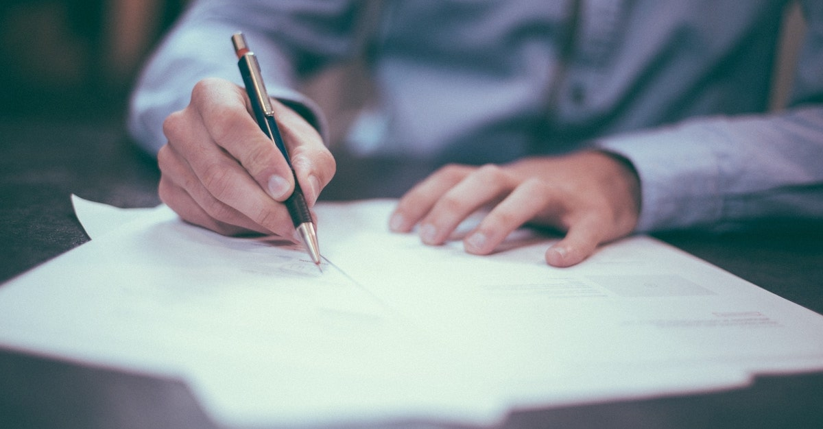 state bar association resources feature image blog post. Man writing with fancy pen.